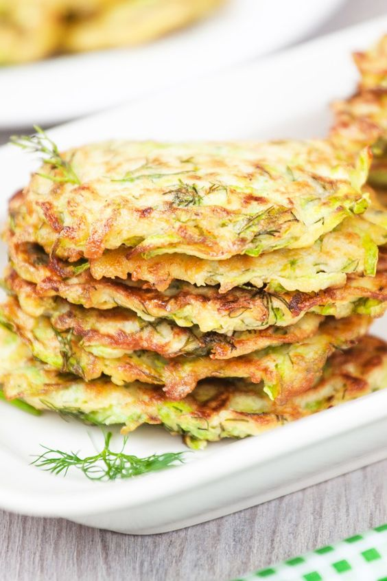 Weight Watchers Zucchini Pancakes stacked on a white plate