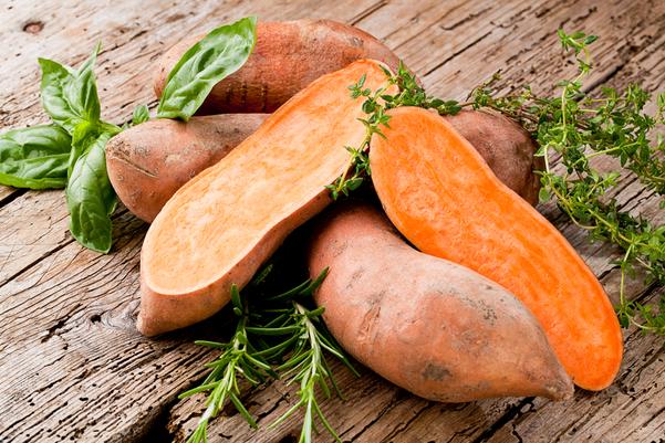 Sweet Potatoes on a cutting board